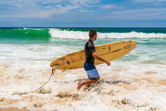 Byron Bay beach Surfing e1552132399821 - Things To Do In New South Wales, Australia